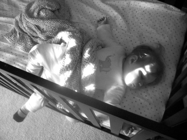 Some like one foot poking out of the blankets. She seems to prefer the crib slat.